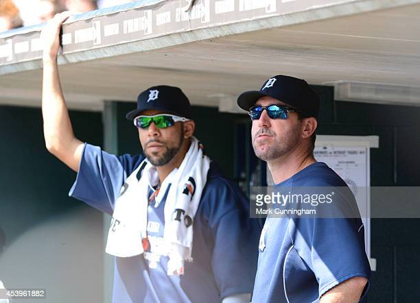 David Price and Justin Verlander of the Detroit Tigers look on from the dugout during the game against the Seattle Mariners at Comerica Park on...