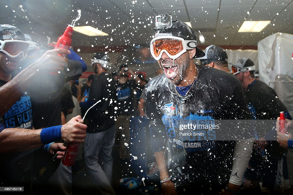David Price and the Toronto Blue Jays celebrate in the clubhouse after defeating the Baltimore Orioles and clinching the AL East Division following...