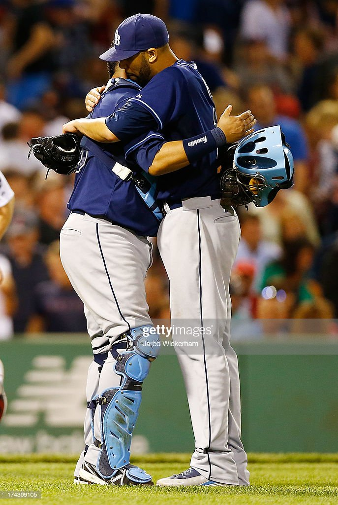 David Price #14 celebrates with Jose Molina #28 of the Tampa Bay Rays following his complete game win against the Boston Red Sox in the 9th inning during the game on July 24, 2013 at Fenway Park in Boston, Massachusetts.