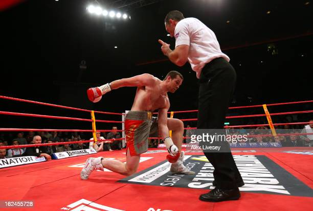 David Price of Great Britain is knocked down by Tony Thompson of USA and the referee stops the contest in round two during the International...