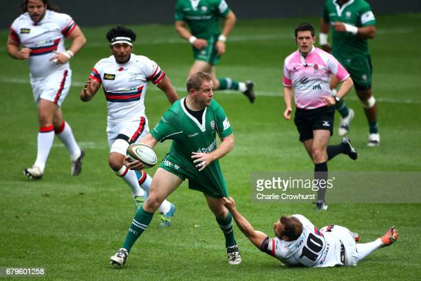 David Price of London Irish looks to get through the Doncaster defence during the Greene King IPA Championship Semi Final match between London Irish...