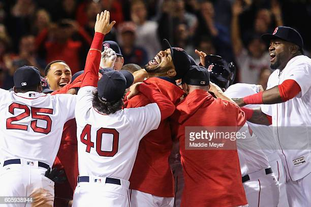 David Price of the Boston Red Sox center and David Price right celebrate with Hanley Ramirez as he crosses home plate after hitting the game winning...
