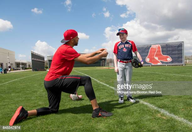 David Price of the Boston Red Sox gives a lesson to MakeAWish recipient Robert Alpert of Wareham Massachusetts before a spring training game against...