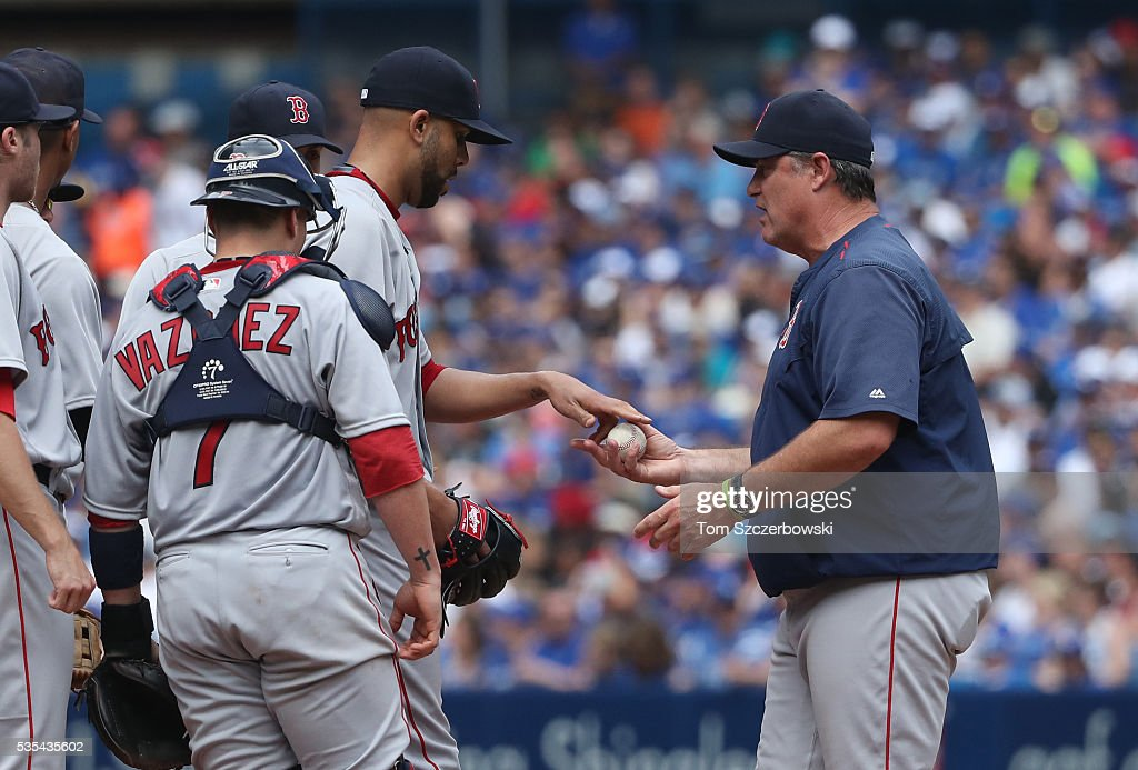 David Price #24 of the Boston Red Sox hands the ball to manager John Farrell #53 as he is relieved in the seventh inning during MLB game action against the Toronto Blue Jays on May 29, 2016 at Rogers Centre in Toronto, Ontario, Canada.