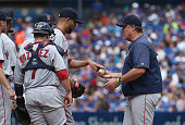 David Price of the Boston Red Sox hands the ball to manager John Farrell as he is relieved in the seventh inning during MLB game action against the...
