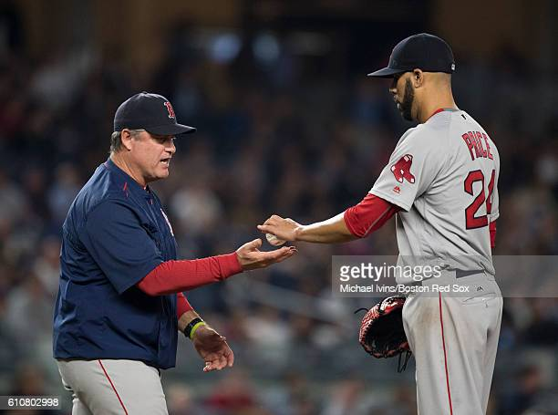 David Price of the Boston Red Sox hands the ball to manager John Farrell after being pulled form the game against the New York Yankees in the seventh...
