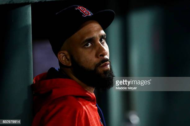 David Price of the Boston Red Sox looks on from the dugout during the fifth inning against the St Louis Cardinals at Fenway Park on August 16 2017 in...
