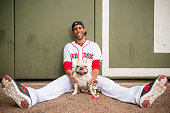 David Price of the Boston Red Sox poses for a portrait with his dog Astro on February 22 2016 at Fenway South in Fort Myers Florida