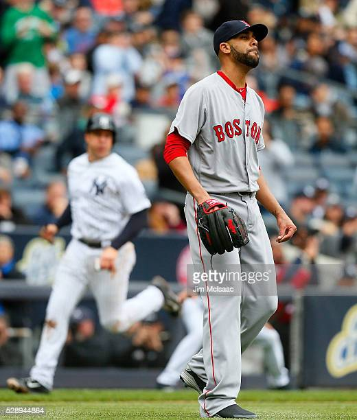 David Price of the Boston Red Sox reacts after surrendering a fourth inning three run double as Mark Teixeira of the New York Yankees scores a run at...