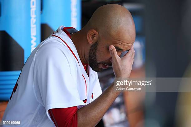 David Price of the Boston Red Sox sits in the dugout after being pulled from the game in the fourth inning of the game against the Tampa Bay Rays at...