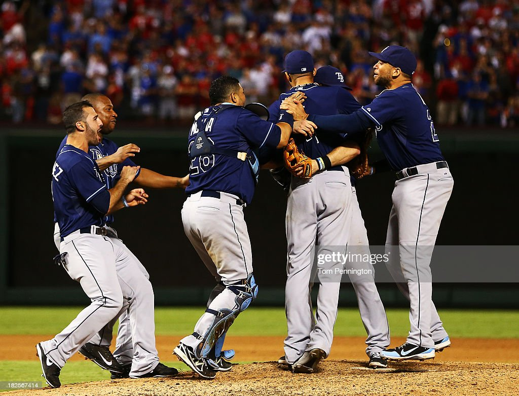 <a gi-track='captionPersonalityLinkClicked' href=/galleries/search?phrase=David+Price+-+Baseball+Player&family=editorial&specificpeople=4961936 ng-click='$event.stopPropagation()'>David Price</a> #14 of the Tampa Bay Rays celebrates with teammates after defeating the Texas Rangers 5 to 2 in the American League Wild Card tiebreaker game at Rangers Ballpark in Arlington on September 30, 2013 in Arlington, Texas.