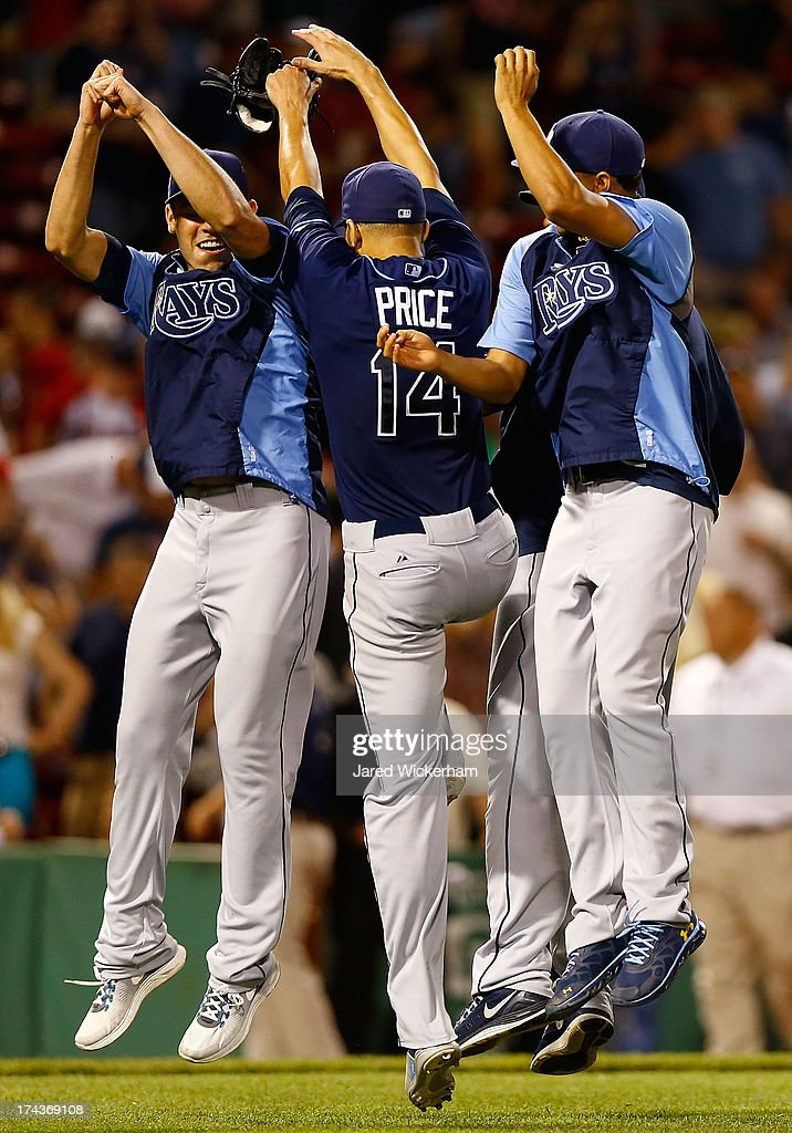 David Price #14 of the Tampa Bay Rays celebrates with teammates following his complete game win against the Boston Red Sox in the 9th inning during the game on July 24, 2013 at Fenway Park in Boston, Massachusetts.
