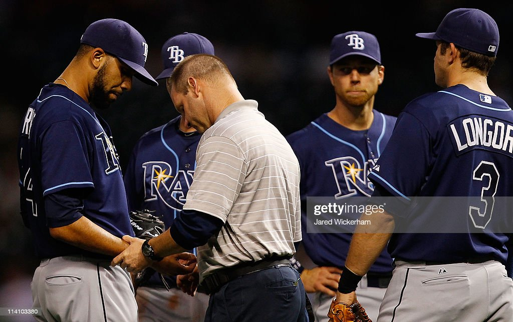 <a gi-track='captionPersonalityLinkClicked' href=/galleries/search?phrase=David+Price+-+Baseball+Player&family=editorial&specificpeople=4961936 ng-click='$event.stopPropagation()'>David Price</a> #14 of the Tampa Bay Rays had his hand looked at by the team trainer after being hit by a line drive during the game against the Cleveland Indians on May 11, 2011 at Progressive Field in Cleveland, Ohio.