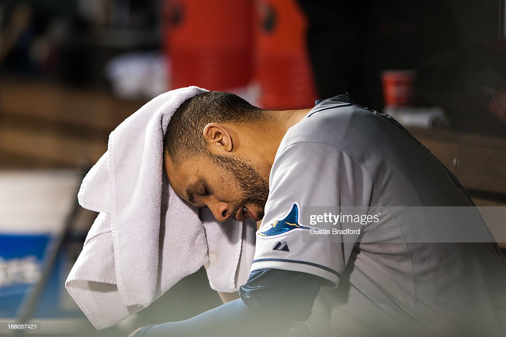 <a gi-track='captionPersonalityLinkClicked' href=/galleries/search?phrase=David+Price+-+Baseball+Player&family=editorial&specificpeople=4961936 ng-click='$event.stopPropagation()'>David Price</a> #14 of the Tampa Bay Rays shows his disappointment as he wipes away his sweat in the dugout after being relieved in the seventh inning of a game against the Colorado Rockies at Coors Field on May 4, 2013 in Denver, Colorado.