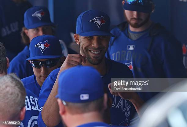 David Price of the Toronto Blue Jays is congratulated by teammates after coming out of the game at the end of the eighth inning during MLB game...