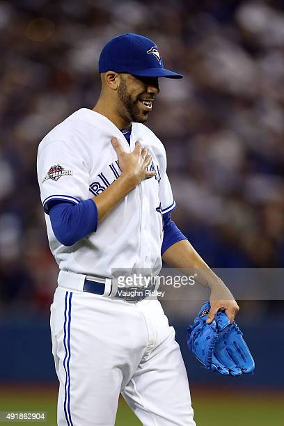 David Price of the Toronto Blue Jays reacts as he walks back to the dugout after the first inning against the Texas Rangers during game one of the...