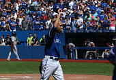 David Price of the Toronto Blue Jays tips his cap to a standing ovation from fans at the end of the eighth inning during MLB game action against the...