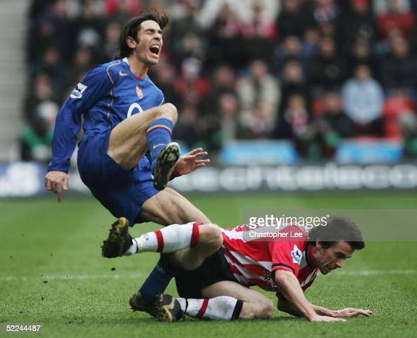 David Prutton of Southampton fouls Robert Pires of Arsenal and is sent off during the Barclays Premiership match between Southampton and Arsenal at...