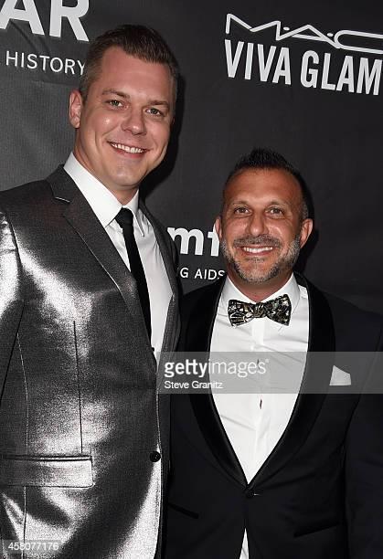 David Pulley and Stephen Macricostas attend amfAR LA Inspiration Gala honoring Tom Ford at Milk Studios on October 29 2014 in Hollywood California