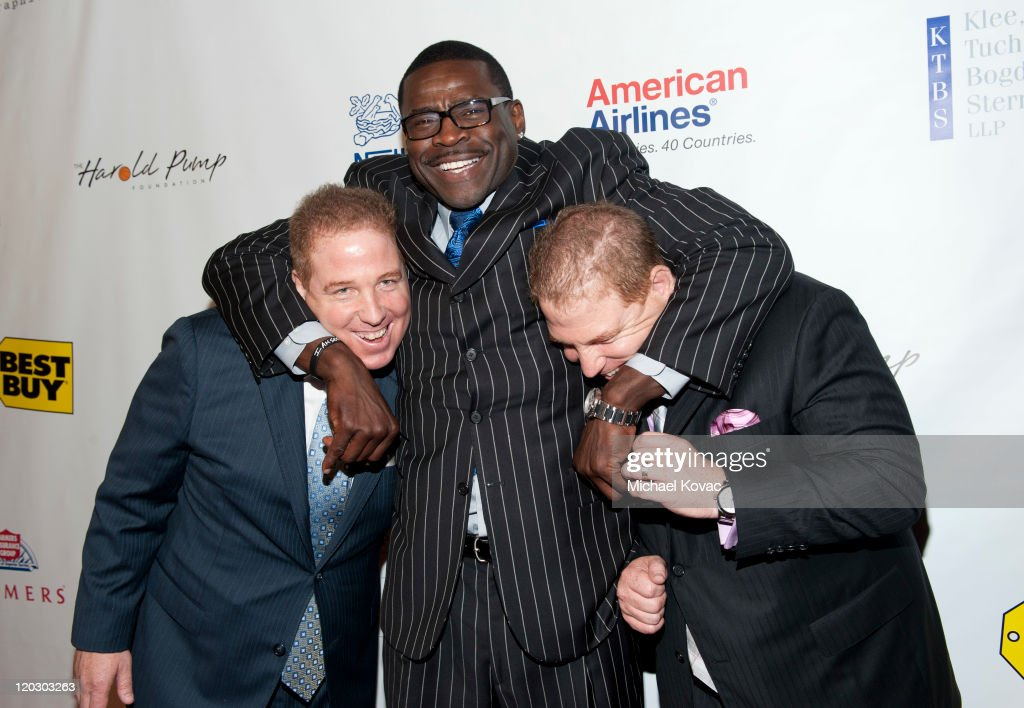 David Pump, former football player <a gi-track='captionPersonalityLinkClicked' href=/galleries/search?phrase=Michael+Irvin&family=editorial&specificpeople=218074 ng-click='$event.stopPropagation()'>Michael Irvin</a> and Dana Pump arrive at the 11th Annual Harold Pump Foundation Gala - Arrivals at the Hyatt Regency Century Plaza on August 3, 2011 in Century City, California.