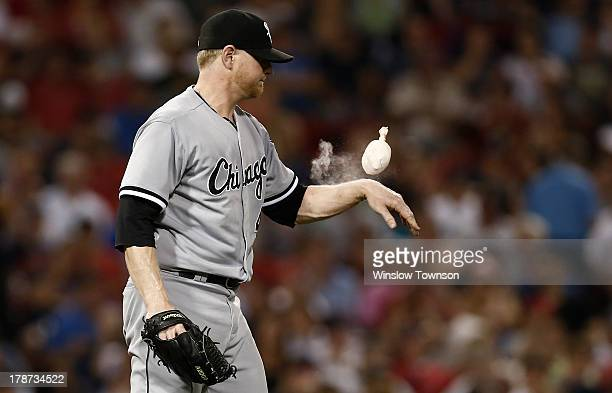 David Purcey of the Chicago White Sox uses the rosin bag during the sixth inning at Fenway Park on August 30 2013 in Boston Massachusetts