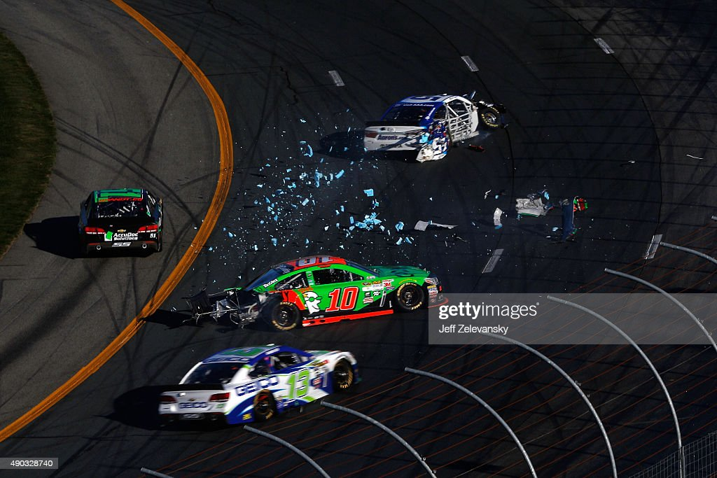 <a gi-track='captionPersonalityLinkClicked' href=/galleries/search?phrase=David+Ragan&family=editorial&specificpeople=574874 ng-click='$event.stopPropagation()'>David Ragan</a>, driver of the #55 Aaron's Dream Machine Toyota, and <a gi-track='captionPersonalityLinkClicked' href=/galleries/search?phrase=Danica+Patrick&family=editorial&specificpeople=183352 ng-click='$event.stopPropagation()'>Danica Patrick</a>, driver of the #10 GoDaddy Chevrolet, are involved in an on-track incident during the NASCAR Sprint Cup Series SYLVANIA 300 at New Hampshire Motor Speedway on September 27, 2015 in Loudon, New Hampshire.