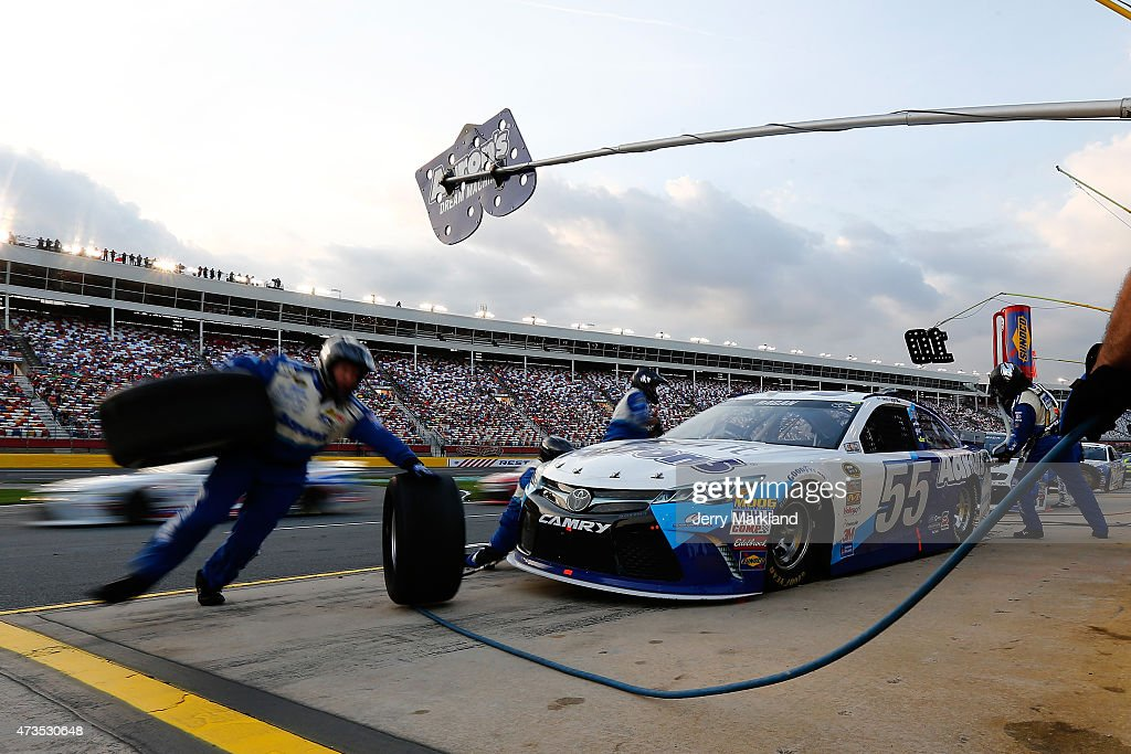 <a gi-track='captionPersonalityLinkClicked' href=/galleries/search?phrase=David+Ragan&family=editorial&specificpeople=574874 ng-click='$event.stopPropagation()'>David Ragan</a>, driver of the #55 Aaron's Dream Machine Toyota, pits during the NASCAR Sprint Cup Series Sprint Showdown at Charlotte Motor Speedway on May 15, 2015 in Charlotte, North Carolina.