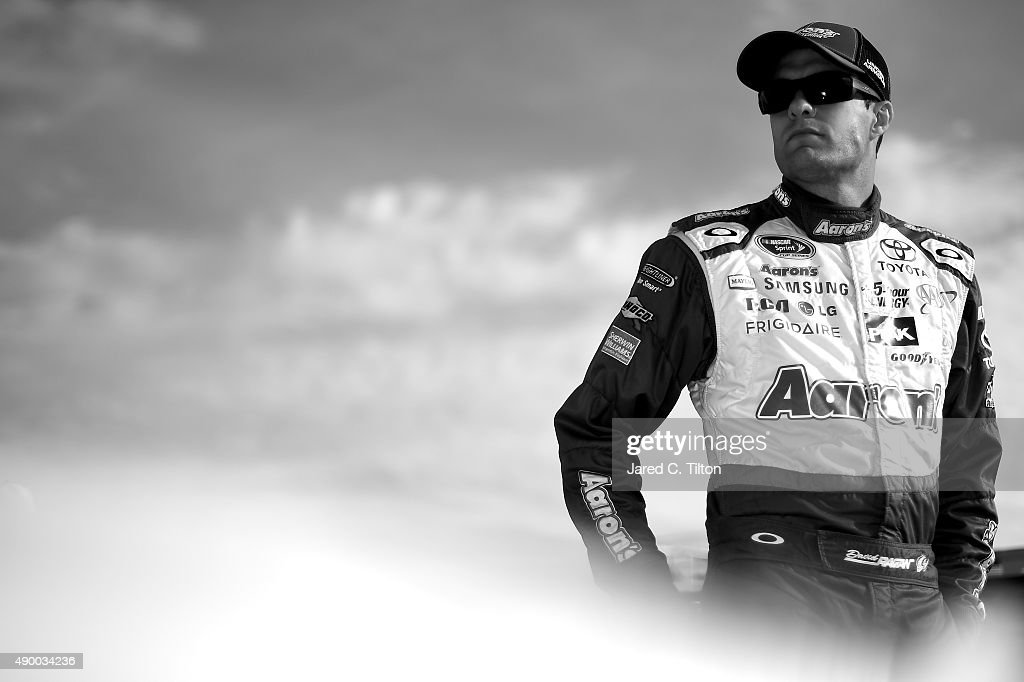 <a gi-track='captionPersonalityLinkClicked' href=/galleries/search?phrase=David+Ragan&family=editorial&specificpeople=574874 ng-click='$event.stopPropagation()'>David Ragan</a>, driver of the #55 Aaron's Dream Machine Toyota, stands on the grid during qualifying for the NASCAR Sprint Cup Series Sylvania 300 at New Hampshire Motor Speedway on September 25, 2015 in Loudon, New Hampshire.