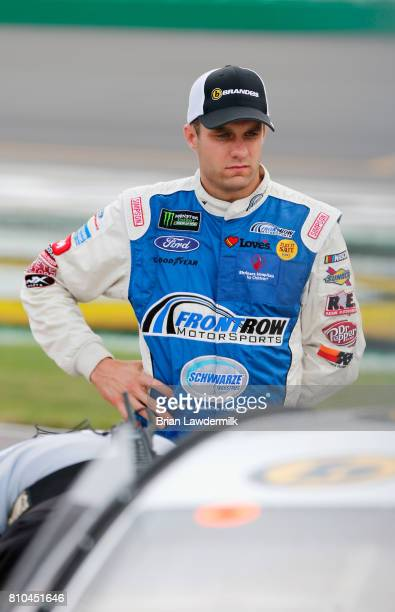 David Ragan driver of the Brandeis/Komatsu Ford stands on the grid during qualifying for the Monster Energy NASCAR Cup Series Quaker State 400...