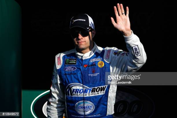 David Ragan driver of the Brandeis/Komatsu Ford waves to the crowd before the Monster Energy NASCAR Cup Series Quaker State 400 presented by Advance...
