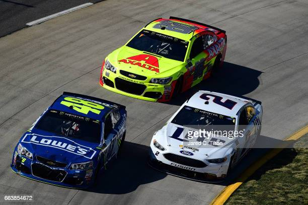 David Ragan driver of the Camping World/Good Sam Ford leads Brad Keselowski driver of the Miller Lite Ford and Dale Earnhardt Jr driver of the Axalta...