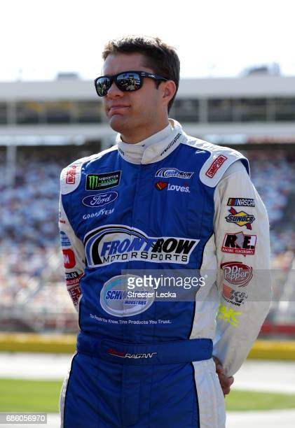 David Ragan driver of the Dockside Logistics Ford stands on the grid during the Monster Energy NASCAR Open Qualifying at Charlotte Motor Speedway on...