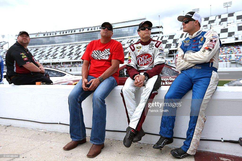 <a gi-track='captionPersonalityLinkClicked' href=/galleries/search?phrase=David+Ragan&family=editorial&specificpeople=574874 ng-click='$event.stopPropagation()'>David Ragan</a>, driver of the #23 Dr Pepper Toyota, and <a gi-track='captionPersonalityLinkClicked' href=/galleries/search?phrase=David+Gilliland&family=editorial&specificpeople=543432 ng-click='$event.stopPropagation()'>David Gilliland</a>, driver of the #35 Ford, talk on the grid during qualifying for the NASCAR Sprint Cup Series Daytona 500 at Daytona International Speedway on February 14, 2016 in Daytona Beach, Florida.
