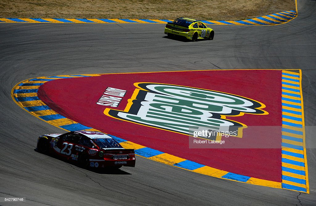 David Ragan, driver of the #23 Dr Pepper Toyota, and Matt Kenseth, driver of the #20 Dollar General Toyota, drive during practice for the NASCAR Sprint Cup Series Toyota/Save Mart 350 at Sonoma Raceway on June 24, 2016 in Sonoma, California.