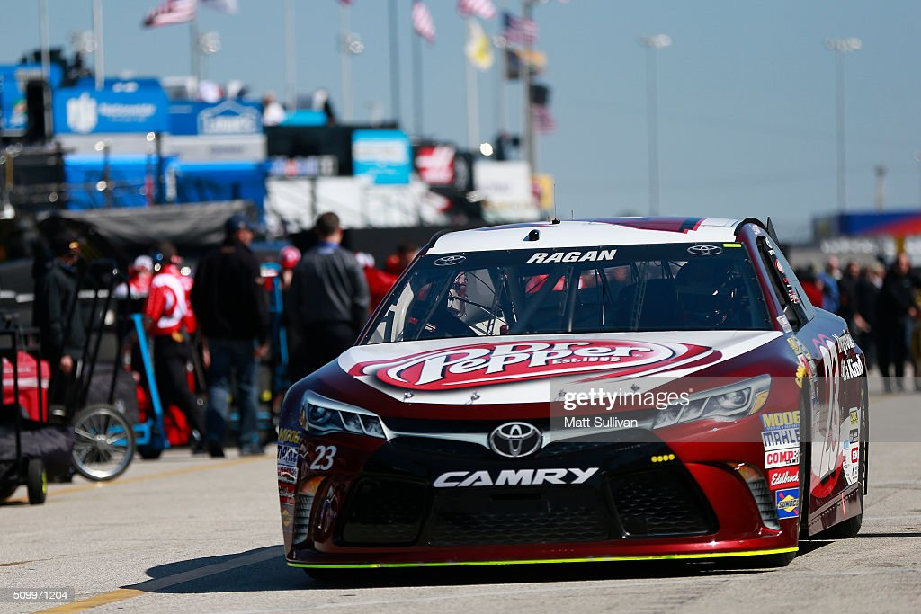 <a gi-track='captionPersonalityLinkClicked' href=/galleries/search?phrase=David+Ragan&family=editorial&specificpeople=574874 ng-click='$event.stopPropagation()'>David Ragan</a>, driver of the #23 Dr Pepper Toyota, drives through the garage area during practice for the NASCAR Sprint Cup Series Daytona 500 at Daytona International Speedway on February 13, 2016 in Daytona Beach, Florida.