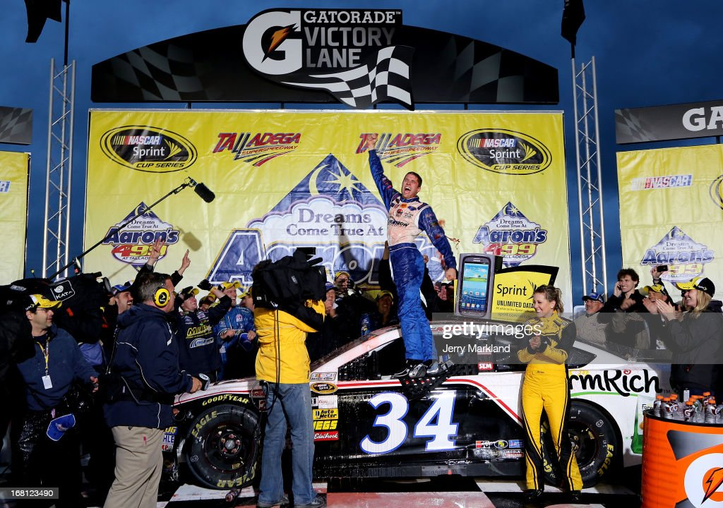 David Ragan, driver of the #34 Farm Rich Ford, celebrates in victory lane after winning the NASCAR Sprint Cup Series Aaron's 499 at Talladega Superspeedway on May 5, 2013 in Talladega, Alabama.