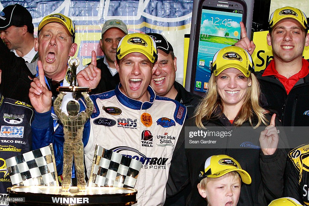 David Ragan, driver of the #34 Farm Rich Ford, celebrates in Victory Lane with wife Jacquelyn Butler Ragan after winning the NASCAR Sprint Cup Series Aaron's 499 at Talladega Superspeedway on May 5, 2013 in Talladega, Alabama.