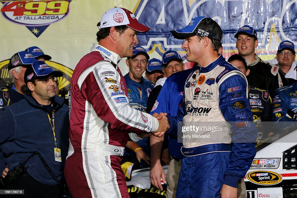 David Ragan, driver of the #34 Farm Rich Ford, is congratulated by Michael Waltrip, driver of the #55 Aaron's Dream Machine / Alabama National Championship Toyota, in Victory Lane after winning the NASCAR Sprint Cup Series Aaron's 499 at Talladega Superspeedway on May 5, 2013 in Talladega, Alabama.