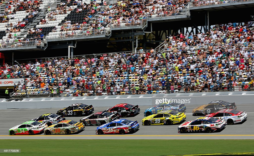David Ragan, driver of the #34 Farm Rich Ford, leads a pack of cars during the NASCAR Sprint Cup Series Coke Zero 400 at Daytona International Speedway on July 6, 2014 in Daytona Beach, Florida.