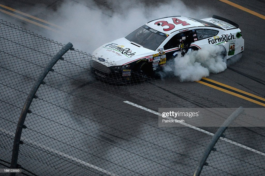 David Ragan, driver of the #34 Farm Rich Ford, performs a burnout in celebration of winning the NASCAR Sprint Cup Series Aaron's 499 at Talladega Superspeedway on May 5, 2013 in Talladega, Alabama.