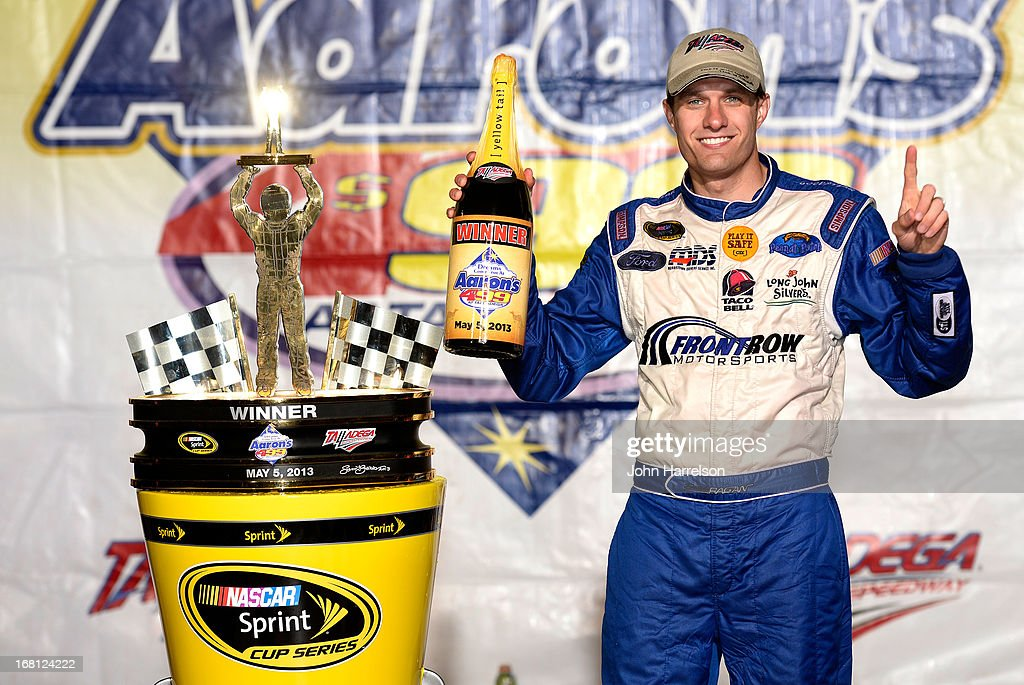 David Ragan, driver of the #34 Farm Rich Ford, poses in victory lane after winning the NASCAR Sprint Cup Series Aaron's 499 at Talladega Superspeedway on May 5, 2013 in Talladega, Alabama.