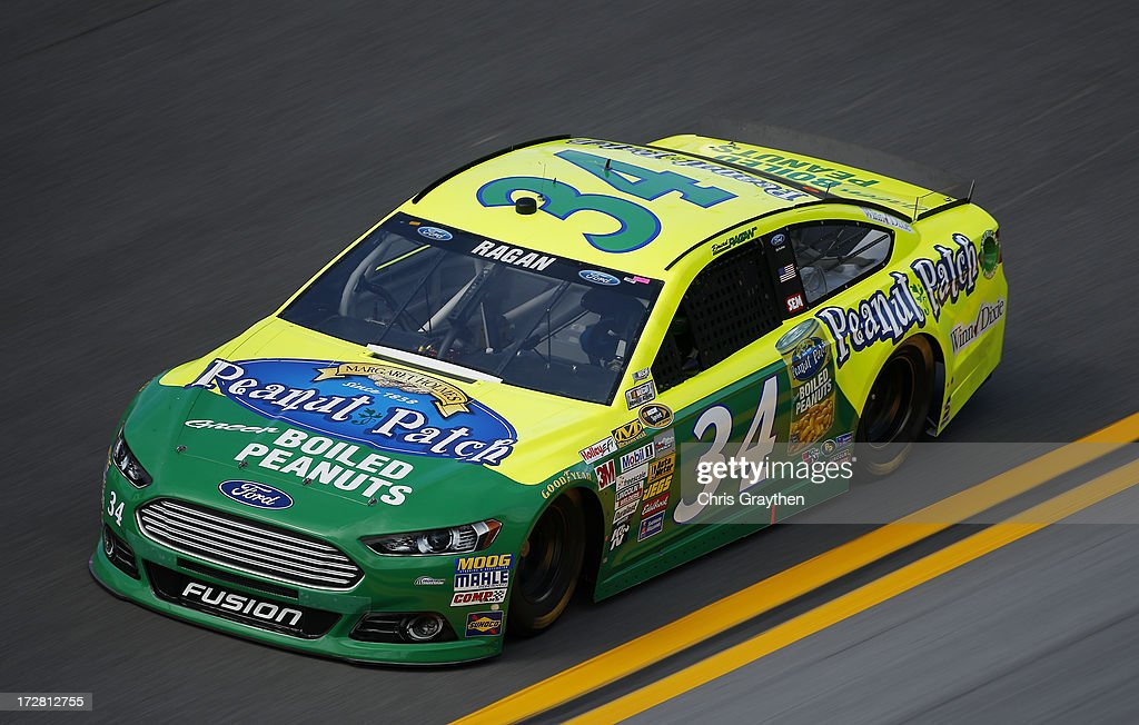 David Ragan, driver of the #34 Peanut Patch Boiled Peanuts Ford, races during practice for the NASCAR Sprint Cup Series Coke Zero 400 at Daytona International Speedway on July 4, 2013 in Daytona Beach, Florida.