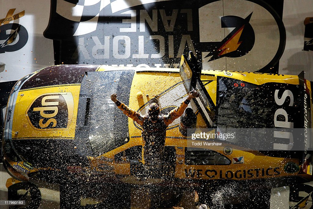 <a gi-track='captionPersonalityLinkClicked' href=/galleries/search?phrase=David+Ragan&family=editorial&specificpeople=574874 ng-click='$event.stopPropagation()'>David Ragan</a>, driver of the #6 UPS Ford, celebrates with his crew in victory lane after he won the NASCAR Sprint Cup Series Coke ZERO 400 Powered by Coca-Cola at Daytona International Speedway on July 2, 2011 in Daytona Beach, Florida.