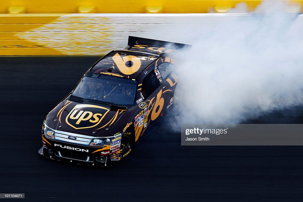 <a gi-track='captionPersonalityLinkClicked' href=/galleries/search?phrase=David+Ragan&family=editorial&specificpeople=574874 ng-click='$event.stopPropagation()'>David Ragan</a>, driver of the #6 UPS Ford, spins out on the tri-oval after losing control around turn 4 during qualifying for the NASCAR Sprint Cup Series Coca-Cola 600 at Charlotte Motor Speedway on May 27, 2010 in Concord, North Carolina.