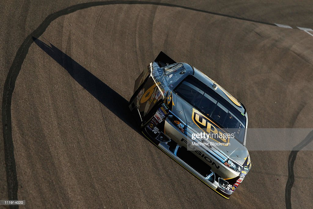 <a gi-track='captionPersonalityLinkClicked' href=/galleries/search?phrase=David+Ragan&family=editorial&specificpeople=574874 ng-click='$event.stopPropagation()'>David Ragan</a> drives the #6 UPS Freight Ford during qualifying for the NASCAR Sprint Cup Series Samsung Mobile 500 at Texas Motor Speedway on April 8, 2011 in Fort Worth, Texas.