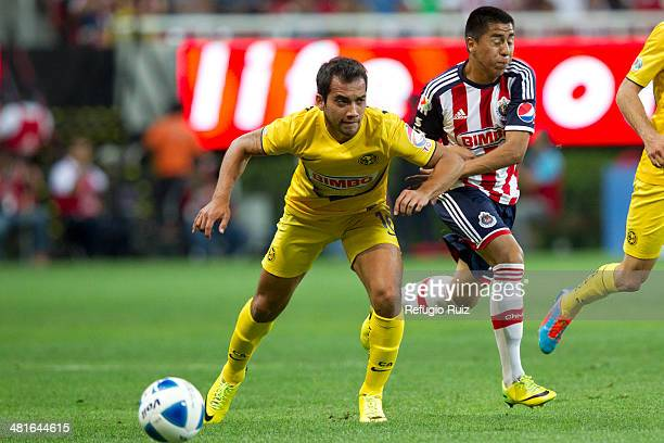 David Ramirez of Chivas fights for the ball with Adrian Aldrete of America during a match between Chivas and America as part of the 13th round of...