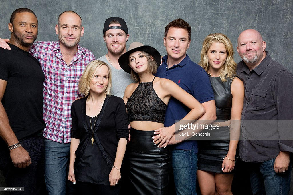 David Ramsey, Paul Blackthorne, Wendy Mericle, Stephen Amell, Willa Holland, John Barrowman, Emily Bett Rickards, Marc Guggenheim of 'Arrow' pose for a portrait at Comic-Con International 2015 for Los Angeles Times on July 9, 2015 in San Diego, California. PUBLISHED IMAGE.