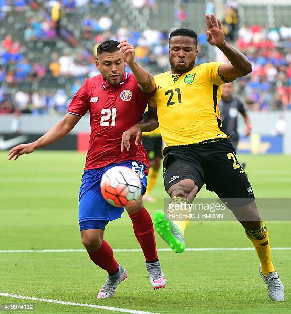 David Razmirez of Costa Rica vies for the ball with Jermaine Taylor of Jamaica during their 2015 Concacaf Gold Cup match in Carson California on July...