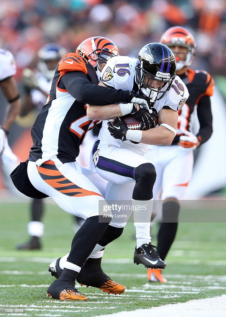 David Reed #16 of the Baltimore Ravens runs with the ball while defended by <a gi-track='captionPersonalityLinkClicked' href=/galleries/search?phrase=Taylor+Mays&family=editorial&specificpeople=3955468 ng-click='$event.stopPropagation()'>Taylor Mays</a> #26 of the Cincinnati Bengals during the NFL gameat Paul Brown Stadium on December 30, 2012 in Cincinnati, Ohio.