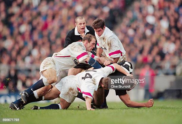 David Rees Lawrence Dallaglio and Phil de Glanville of England tackle Jonah Lomu of New Zealand during the match against the New Zealand All Blacks...